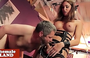 Busty transsexual dominates male